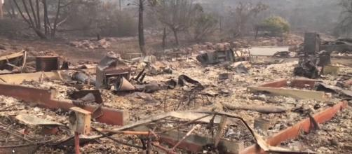 Homes gone to ashes after scorching wildfires. Image Credit: Guardian News/ Youtube screencap
