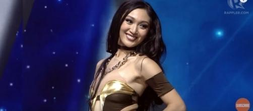 The delegate from the Philippines wearing her swimsuit attire. [Image Credit/Rappler/YouTube]