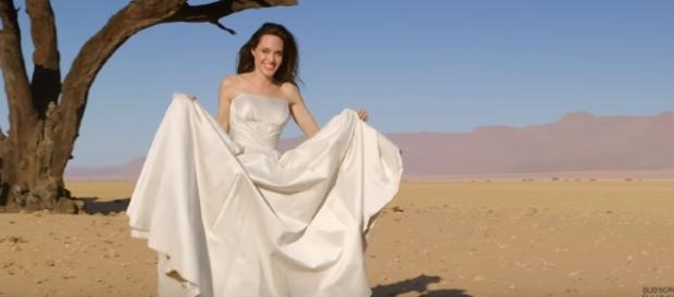 Angelina Jolie poses for Harper's Bazaar magazine cover with the cheetahs. YouTube/HarpersBazaar