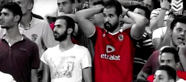 Egyptian football fans wait in suspense just before Mohamed Salah scores the winning goal. Photo via Foot Goal/YouTube.
