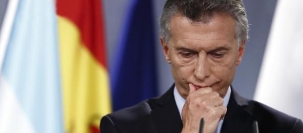 Macri en España dando una conferencia