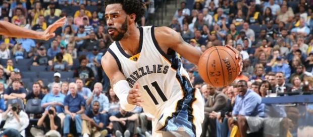 Mike Conley and the Grizzlies host the Houston Rockets in a Wednesday night preseason game. [Image via NBA/YouTube]