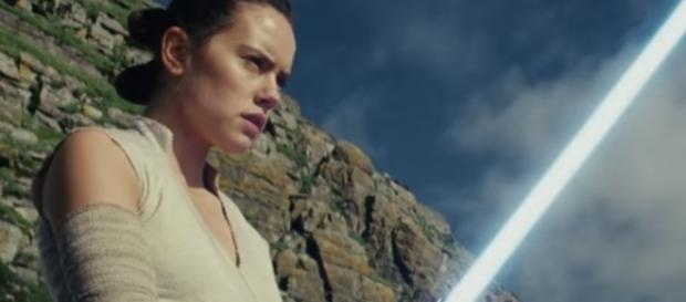 """Rey wields Luke Skywalker's lightsaber in 'Star Wars: The Last Jedi."""" (Photo:YouTube/Star Wars)"""
