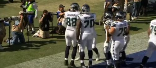 Seahawks' offense celebrating after a touchdown (Image Credit via NFL/YouTube)