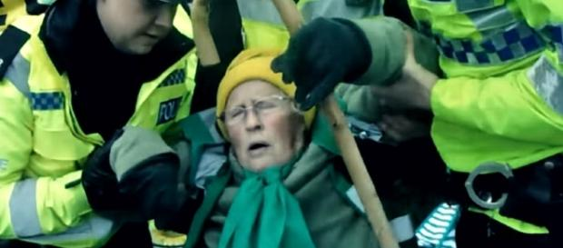 An elderly anti-fracking protester was treated brutally by police in the U.K. [Image credit: RT/YouTube]