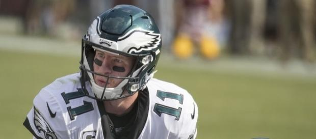 Carson Wentz behind center 2017 [Image by Keith Allison|Wikimedia Commons| Cropped | CC BY-SA 2.0 ]