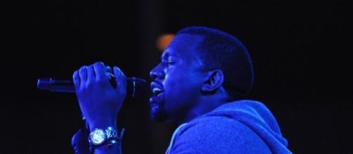 Kanye West performing onstage. [Image Credit: Jason Perrse/Flickr]