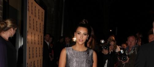 Kim Kardashian poses for the paparazzi. [Image Credit: Eva Rinaldi/Flickr]