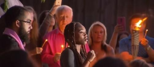 Prayer vigil by tree where Sherin Mathews was last seen in Richardson, TX. (Image credit- CBSDFW/YouTube)