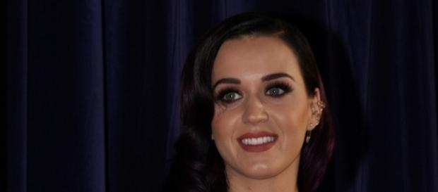 Katy Perry poses for a photograph. [Image Credit: Eva Rinaldi/Flickr]