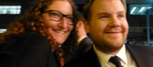 James Corden poses with a fan. [Image Credit: GabboT/Flickr]