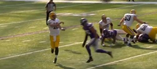 Packers quarterback Aaron Rodgers shown after releasing the ball and before he was hit. -- YouTube screen capture / ESPN