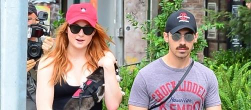 Sophie Turner and Joe Jonas (shown with adopted husky) are now engaged according to their Sunday announcement. | Credit (E! News/YouTube)