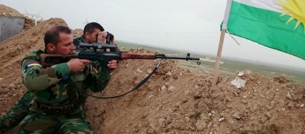 Peshmerga fighter in 2015 / [Image credit: Kurdishstruggle/Flickr]