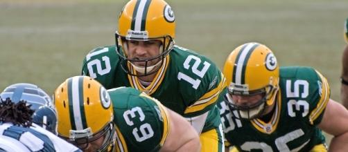 Aaron Rodgers (#12 above) of the Green Bay Packers (Wikimedia/Mike Morbeck)