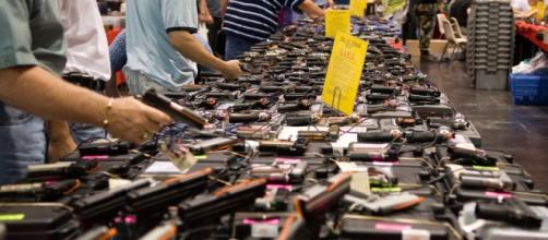 Customers shop for guns at a past gun show in Houston.[image credit - M&R Glasgow/flikr.com]