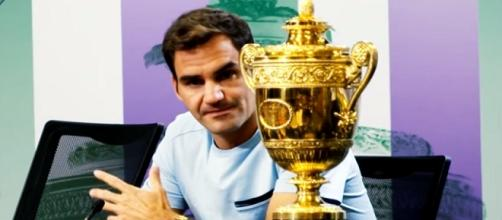 Roger Federer and his eighth Wimbledon trophy/ Photo: screenshot via ATPWorldTour channel on YouTube