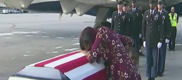 The widow of Sgt. La David T. Johnson gets emotional as her husband's body returns home - Image via YouTube screenshot