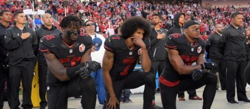 Former 49ers quarterback, Colin Kaepernick, kneels during national anthem in protest... - Image via pbs.org