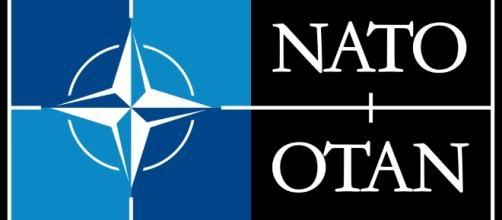 NATO/OTAN Logo by Unknown/Wikimedia Commons