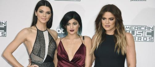 The Kardashian sisters pose on the red carpet. [Image Credit: Disney ABC Television/ Flickr]