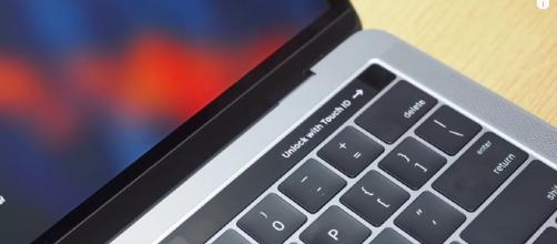 Apple's newest laptop features a touch bar which includes a multitude of features. [Image via SlashGear/YouTube screencap]