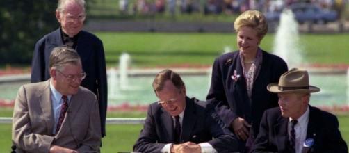 Former President Bush signs ADA in 1990 - ability360.org