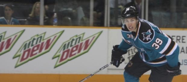 NHL 3rd Star Couture bites Rangers. [Image credit: SJ Sharks Teal And White Game/Wikimedia Commons]
