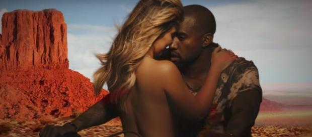 The couple's security team reportedly pulled guns on the intruder. [Image via KanyeWestVevo/YouTube screencap]