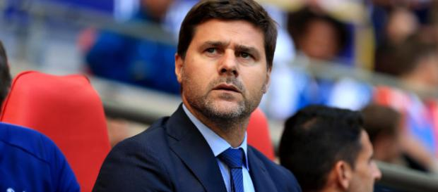 Tottenham manager Mauricio Pochettino looks on - squawka.com