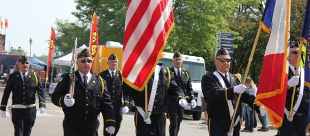Veterans parading. Photo credit Cynthia Peterson-pixabay.com