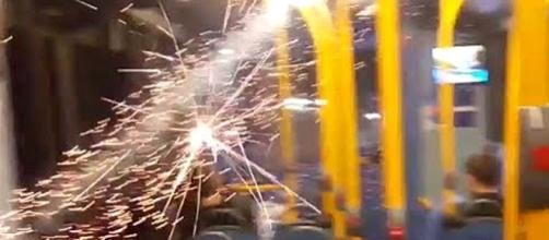 Youths in London threw a lit firework into a bus, causing panic among passengers [Image credit: Apostolos/YouTube]