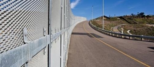 Border Fence near San Diego (Image credit - Josh Denmark – Wikimedia Commons)