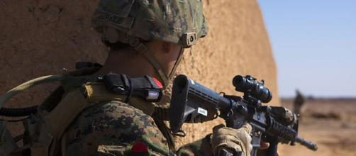 Marine in Afghanistan [image courtesy Defense Department wikimedia commons]