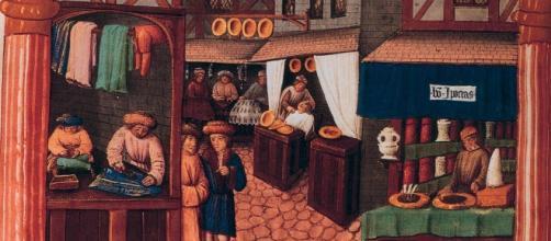 Scene di strada in un villaggio medievale