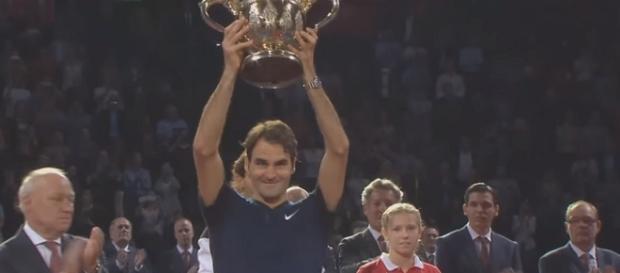 Rpger Federer celebrating his 2015 Swiss Indoors Basel title/ Photo: screenshot via Tennis TV channel on YouTube