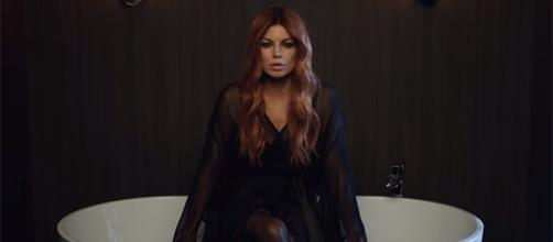 Fergie gets emotional in talking about her breakup with ex-husband, Josh Duhamel. (FergieVEVO/YouTube)