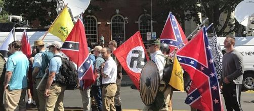White supremacists during the Unite the Right Rally in Charlottesville this year. [Image via Anthony Crider/Wikimedia Commons]