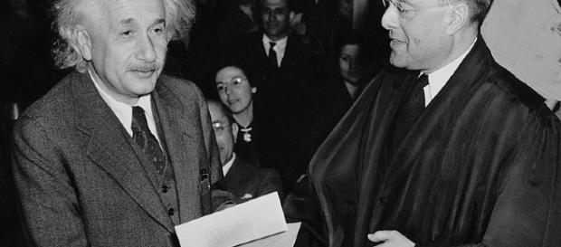 Albert Einstein receiving from Judge Phillip Forman his certificate of American citizenship. [image via Al. Aumuller, Wikimedia Commons]