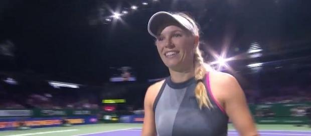 Caroline Wozniacki celebrates her win in Singapore. [Image Credit: WTA/YouTube]