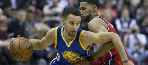 Stephen Curry reacts to getting fined for mouthpiece throwing. (Image Credit - Keith Allison/Flickr)