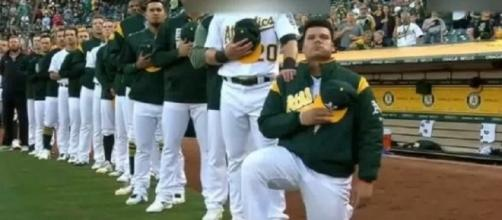 Bruce Maxwell knelt in defiance after Trump's insulting remarks. [Image Credit: 2017 FlashTrendinG/YouTube]