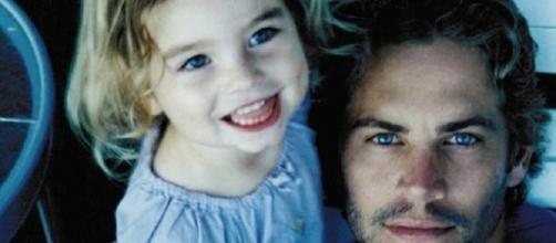 Meadow, quando criança, com Paul Walker