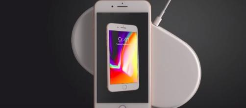 Wireless charging looks and sounds amazing but doesn't ease charging problems. [Image via Apple/YouTube]