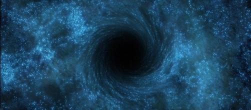 Representação artística de um buraco negro (dos grandes!)