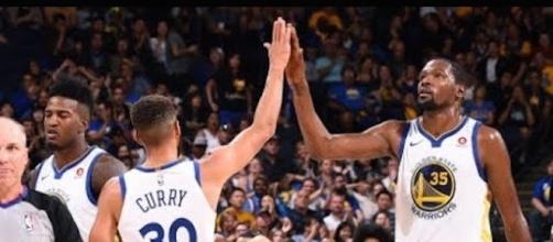 Stephen Curry, Kevin Durant, and the Warriors host the Wizards on Friday night. [Image via NBA/YouTube]