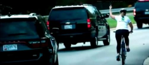 A female cyclist was seen to give Donald Trump the middle finger in Virginia. [Image credit: MARYY Official/YouTube]