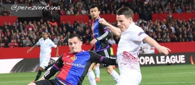 Basel midfielder Taulant Xhaka (Right) tackles Sevilla striker Rami Gameiro in a past match. (Image Credit: Perez-Ventana/Flickr)