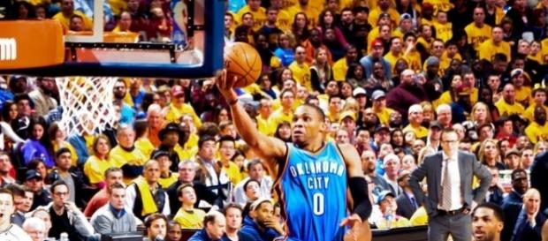 Russell Westbrook goes hard to the basket (Image Credit: Erick Drost/Flickr)