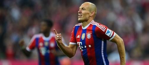 Bayern Munich forwarder Arjen Robben celebrates his goal in a past match. (Image Credit: James Kuslov/Flickr)